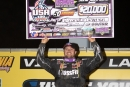 Brandon Overton holds up the big $20,000 check he earned for winning Saturday's Ultimate Southeast Series USA 100 at Virginia Motor Speedway. (Larry Burnett/wrtspeedwerx.com)