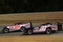 Winner Carson Ferguson (00) stalks Layton Sullivan (08), whose flat tire exiting turn four on the last lap gave Ferguson a $3,000 Fastrak tour victory at Virginia Motor Speedway in Jamaica, Va. (Larry Burnett/wrtspeedwerx.com)