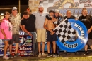 Patrik Daniel's team celebrates his July 19 Southern Texas victory at RPM Speedway in Crandall, Texas. He earned $1,000. (Karen Davis)