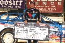 Brandon Sheppard holds the $10,000 check he received for winning the Aug. 16 World of Outlaws Morton Buildings Late Model Series feature at Williams Grove Speedway in Mechanicsburg, Pa. (Eileen Shrey)