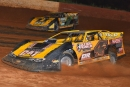 Tommy Kerr (4T) battles teammate Donald McIntosh (7) en route to his $4,000 Schaeffer's Fall Nationals victory Aug. 16 at Smoky Mountain Speedway in Maryville, Tenn. (mrmracing.net)