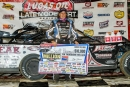 Scott Bloomquist poses in victory lane after winning Aug. 22's first 30-lap Duel preliminary feature on opening night of the Dirt Million weekend at Mansfield (Ohio) Motor Speedway. (heathlawsonphotos.com)