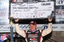 Darrell Lanigan holds the $10,000 check he received for winning the Sept. 21 World of Outlaws Morton Buildings Late Model Series victory at Selinsgrove (Pa.) Speedway. (Rick Neff)