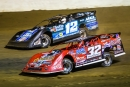 Bobby Pierce (32) overtakes Jason Jameson (12) en route to a heat race win. (heathlawsonphotos.com)