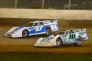 Pennsylvania drivers Rick Eckert (0) and Max Blair (111) battle during Can-Am World Finals heat action on Nov. 9 at The Dirt Track at Charlotte in Concord, N.C. (Brent Smith)