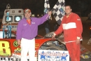 Louisiana driver Kenny Merchant enjoys victory lane following his 50-lap SUPR victory worth $2,500 at I-30 Speedway in Benton, Ark., on April 12, 2003. (Todd Turner)