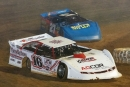 Sam Seawright (16) leads Jay Scott (27) Sunday at Duck River Raceway Park. (Connie Putnam)