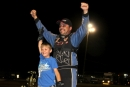 Jesse Stovall celebrates Sunday's $9,000 Comp Cams Super Dirt Series victory at Legit Speedway Park with his son. (Robert Holman/DirtonDirt.com)