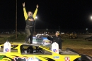 Jim Body climbs atop his car May 29 at Midway Speedway in Lebanon, Mo., after his first Dirt Track Bank Cash Money Super Dirt Series victory. (Justis Mooneyham)