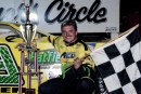 Marshall Green of Dalton, Ga., is all smiles after winning the $5,000 Coca-Cola 100 at Dixie Speedway on July 5, 2002. (Todd Turner)