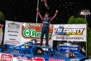 Brandon Sheppard celebrates his $10,000 World of Outlaws victory on July 10 at Outagamie Speedway in Seymour, Wis. (jacynorgaardphotography.com)
