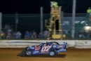 Todd Morrow takes the checkereds in Southern All Stars action at ECM Speedway. (Chris McDill)