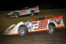 Chad Becker (12) heads for a $10,000 Dacotah Rumble victory July 11 at Brown County Speedway in Aberdeen, S.D. (crpphotos.com)