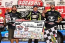 Kyle Strickler is joined by crew members Vinny Guliani (left) and Trey Weaver (right) on Sept. 17 after his first Lucas Oil Late Model Dirt Series victory at I-80 Speedway in Greenwood, Neb. (photosbyboyd.smugmug.com)