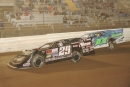Darrell Lanigan (29) moves to the lead over Michael Norris (02) during one of two qualifying features on prelim night of Bedford's Keystone Cup. (Howie Balis)
