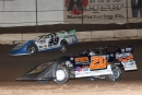 Ricky Thornton Jr. (20rt) works past Jonathan Davenport (49) to capture Jan. 10.'s Keyser Manufacturing Wild West Shootout event at FK Rod Ends Arizona Speedway. (mikerueferphotos.photoreflect.com)