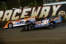Floridians Kyle Bronson (40B) and Mark Whitener (38) battle during Lucas Oil Series heat race action Wednesday night at East Bay Raceway Park near Tampa, Fla. (heathlawsonphotos.com)