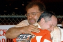 Mike Head (left) hugs Ronnie Johnson after one of his four Michael Head Jr. Memorial victories at Talladega Short Track. Head died Feb. 22, 2021, at the age of 69. (Brian McLeod/Dirt Scenes)