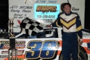 Roger Long of Fithian, Ill., in victory lane at Benton County Speedway in Boswell, Ind., on April 7, 2001 after winning the inaugural event on the United Midwest Promoters Hoosier Series tour. He earned $2,000. (Todd Turner)
