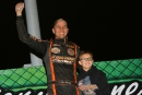 Ryan Unzicker celebrates with his son after winning Friday's $3,000 MARS-sanctioned Thaw Brawl opener at La Salle (Ill.) Speedway. (mikerueferphotos.photoreflect.com)