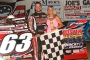 Doug Drown and his wife Joy visit victory lane May 18 at Hilltop Speedway in Millersburg, Ohio after his first career ADRA victory. (Diane Bemiller)
