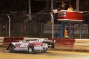 Jim Bernheisel takes the checkers May 18 at Selinsgrove (Pa.) Speedway. (pbase.com/cyberslash)