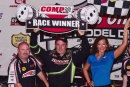 Jimmy Owens enjoys victory lane Aug. 16 for his $40,000 victory in the 22nd annual Topless 100 at Batesville (Ark.) Motor Speedway. (rickschwalliephotos.com)