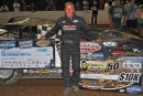 Darrell Lanigan displays the $10,000 checks he received for winning the World of Outlaws Late Model Series Gunter's Honey 50 on Aug. 16 at Winchester (Va.) Speedway. (DirtonDirt.com)