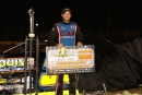 Jason Utter poses with his $3,000 check for winning the Corn Belt Clash Late Model Series feature at Plymouth (Wis.) Dirt Track. (Mike Ruefer)