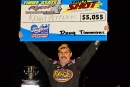 Kenny Pettyjohn holds up his paycheck Aug. 29 at Bedford (Pa.) Speedway after winning the Three State Flyers feature. (wrtspeedwerx.com)