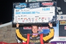 Tim McCreadie holds aloft his $8,000 check for winning Saturday night's 40-lap World of Outlaws Late Model Series feature at Selinsgrove Speedway. (DirtonDirt.com)