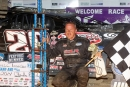 Darrell Lanigan poses in victory lane after capturing the 50-lap Late Model National Open at Selinsgrove (Pa.) Speedway to match his own World of Outlaws Late Model Series single-season win record of 15. (Barry Lenhart)