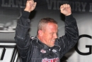 Darrell Lanigan celebrates his record-setting 16th World of Outlaws victory Saturday at Berlin Raceway in Marne, Mich., earning $15,000. (Steve Datema)