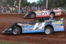 Eventual feature winner Brad Looney (14) battles with Terry Phillips (75) on Sept. 13 at Springfield (Mo.) Raceway's Larry Phillips Memorial. (Ron Mitchell)