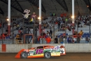 Justin Kay flashes under the checkered flag to win the 35-lap Deery Brothers Summer Series All-Star Classic on Sept. 20 at Davenport (Iowa) Speedway. (Mike Ruefer)