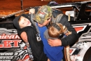 Riley Hickman gets a hug from two of his boys in victory lane Oct. 18 after his Southern All Star victory at Talladega (Ala.) Short Track. (photobyconnie.com)