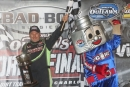 Jimmy Owens shares victory lane with Lugnut after winning Saturday night's Bad Boys Buggies World Finals finale at The Dirt Track at Charlotte. (Barry Lenhart)