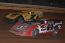 Winner Donald McIntosh (7) and Dylan Ames (44) battle at the outset of Nov. 22's Turkey Gobble 50 at Boyd's Speedway. Ames finished third. (dt52photos.com)