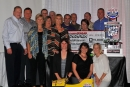 Supporters join Chad Simpson (far right) in picking up his MLRA trophy Oct. 12 in Camdenton, Mo. (fasttrackphotos.net)