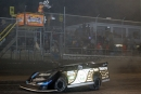Scott Bloomquist flashes under the checkered flag to win Wednesday night's 40-lap UMP DIRTcar-sanctioned feature at Volusia Speedway Park. (stlracing.com)