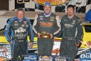 After winning Thursday night's World of Outlaws Late Model Series feature at Volusia Speedway, Shane Clanton (center) was flanked in victory lane by runner-up Don O'Neal (left) and third-place Jonathan Davenport (right). (Troy Bregy)