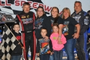 Car owner Stacy Boles (right) joins winner Billy Ogle Jr. (left) and others in victory lane after Ogle's first World of Outlaws victory in Tazewell, Tenn. (mrmracing.net)