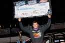 Chris Ferguson holds his $10,000 check for winning Saturday night's World of Outlaws Late Model Series A-Main at Fayetteville (N.C.) Motor Speedway. (Jim DenHamer)