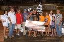 Ray Moore and his supporters enjoy victory lane July 2 at ArkLaTex Speedway in Vivian, La., for his 27th career SUPR victory. (scottscustomart.com)