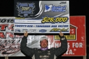 Jonathan Davenport holds aloft the $26,000 check he received for winning the Prairie Dirt Classic at Fairbury American Legion Speedway. (Jim DenHamer)