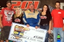 Jackie Boggs holds his big paycheck after his $5,000 victory in 201 Speedway's Bob Miller Memorial on Aug. 1. (Zola Miller)