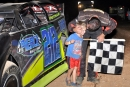 Josh Putnam is greeted by his son in victory lane after his Aug. 1 victory at Thunderhill Raceway in Summertown, Tenn. (photobyconnie.com)