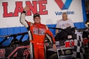 John Ownbey waves from Kentucky Lake Motor Speedway's victory lane after Aug. 29's NeSmith Series victory for Crate Late Models. (Bruce Carroll)