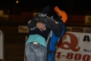 Mason Zeigler hugs his fiancee Amber Johnson after winnin the 60-lap Winternationals finale at East Bay Raceway Park. (heathlawsonphotos.com)