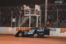 Gregg Satterlee flashes under the checkered flag to win the Stanley Schetrompf Founders Day Classic on April 23 at Hagerstown (Md.) Speedway. (heathlawsonphotos.com)